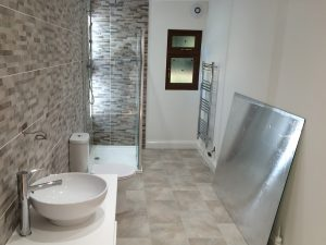 247 Plumbing Solutions of Larkfield, Kent. Beautiful barn bathroom install including plastering, fixtures, shower, flooring, tiling and plumbing in Wrotham, Kent.